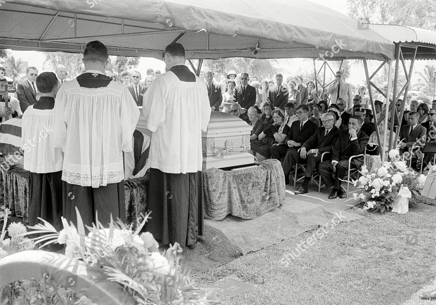 Whitman family sits right priests conduct graveside