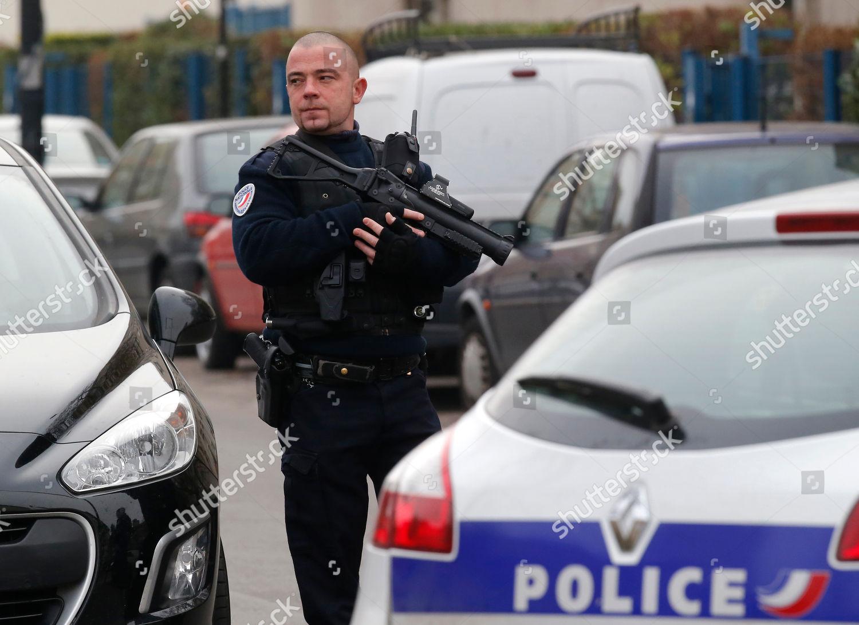 police officer patrols near preschool after masked Editorial Stock