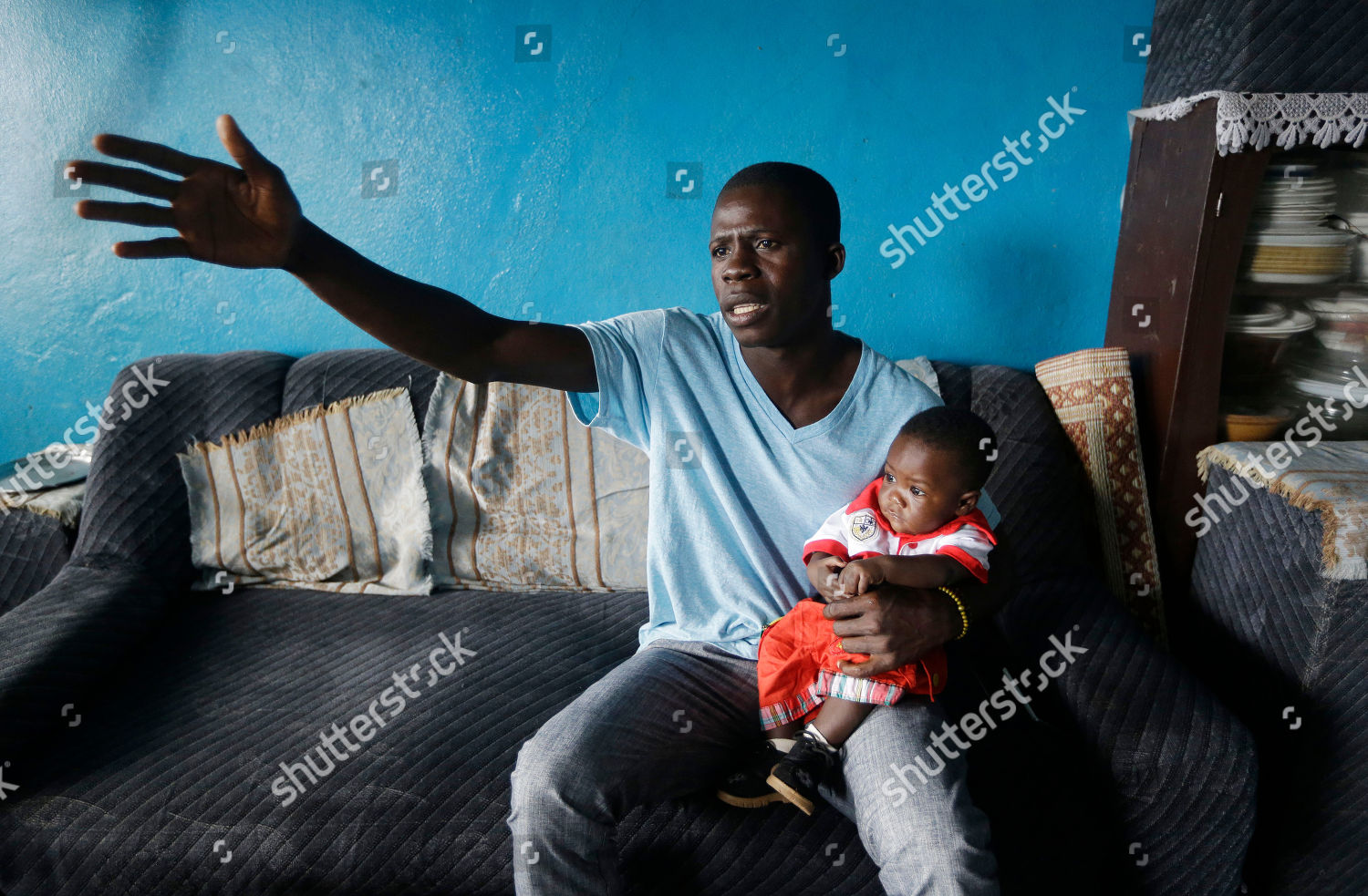 Nurse Donnell Tholley 25 holds his adopted Editorial Stock Photo