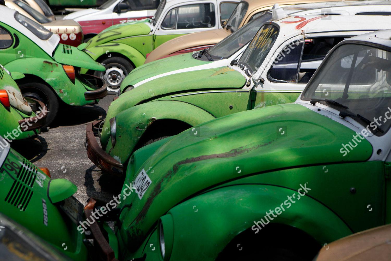 Old Volkswagen beetle taxis sit junk yard Editorial Stock