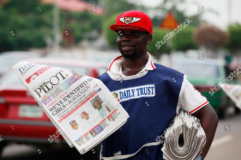 vendor sell local newspapers on street headlines Editorial Stock