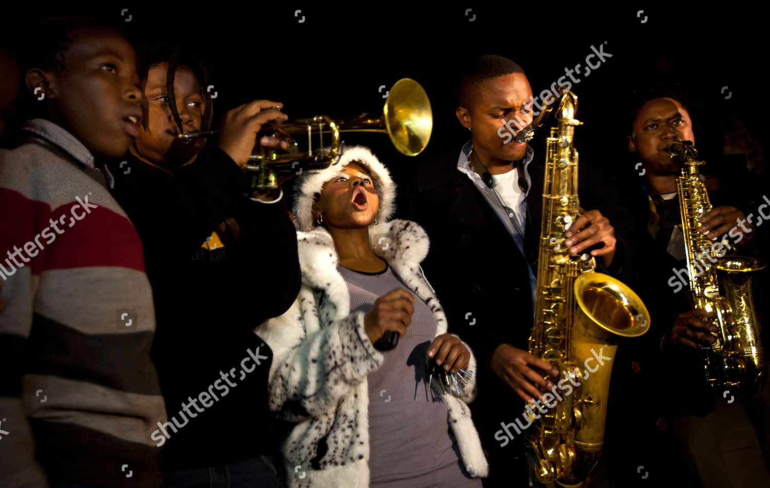 Wellwishers sing songs sound trumpets saxophones show Editorial