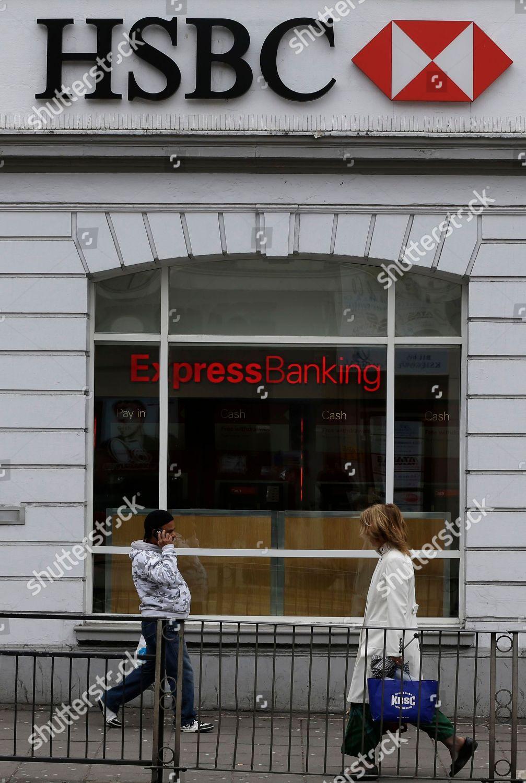 People walk past branch HSBC bank London Editorial Stock Photo