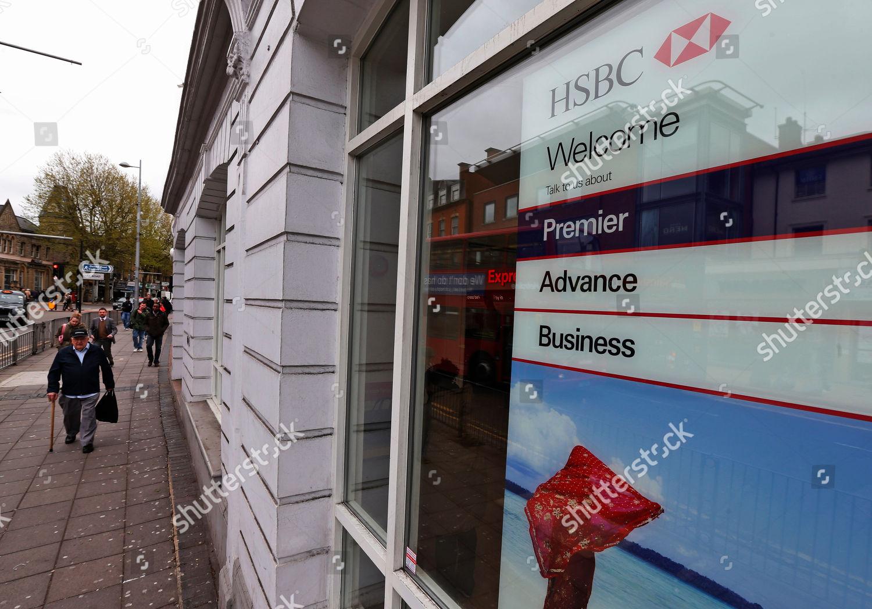 People walk past HSBC bank branch London Editorial Stock Photo