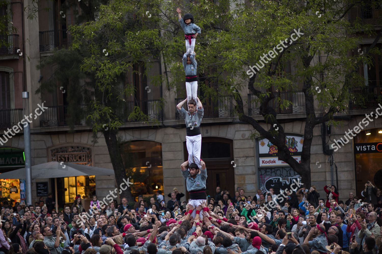 Members Castellers de Sants group form their Editorial Stock
