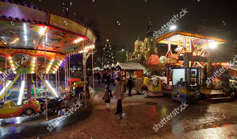 Christmas In Sarajevo.Late Bosnian People Walk Through Christmas Market Editorial