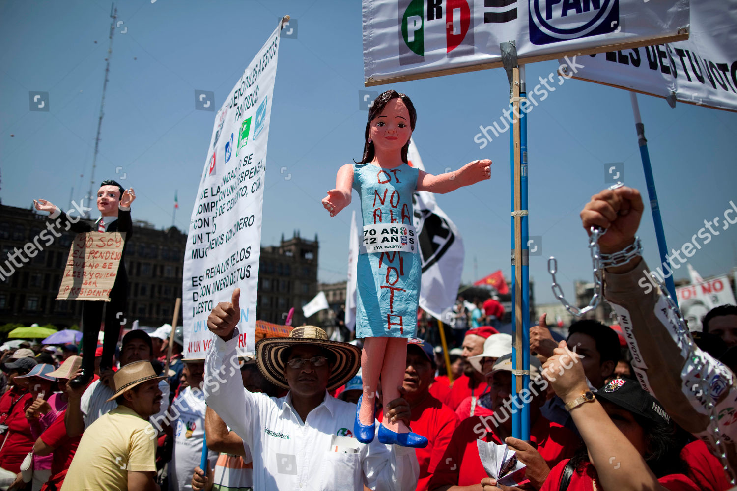 Demonstrator Holds Statue Depicting Mexican Actress Angelica