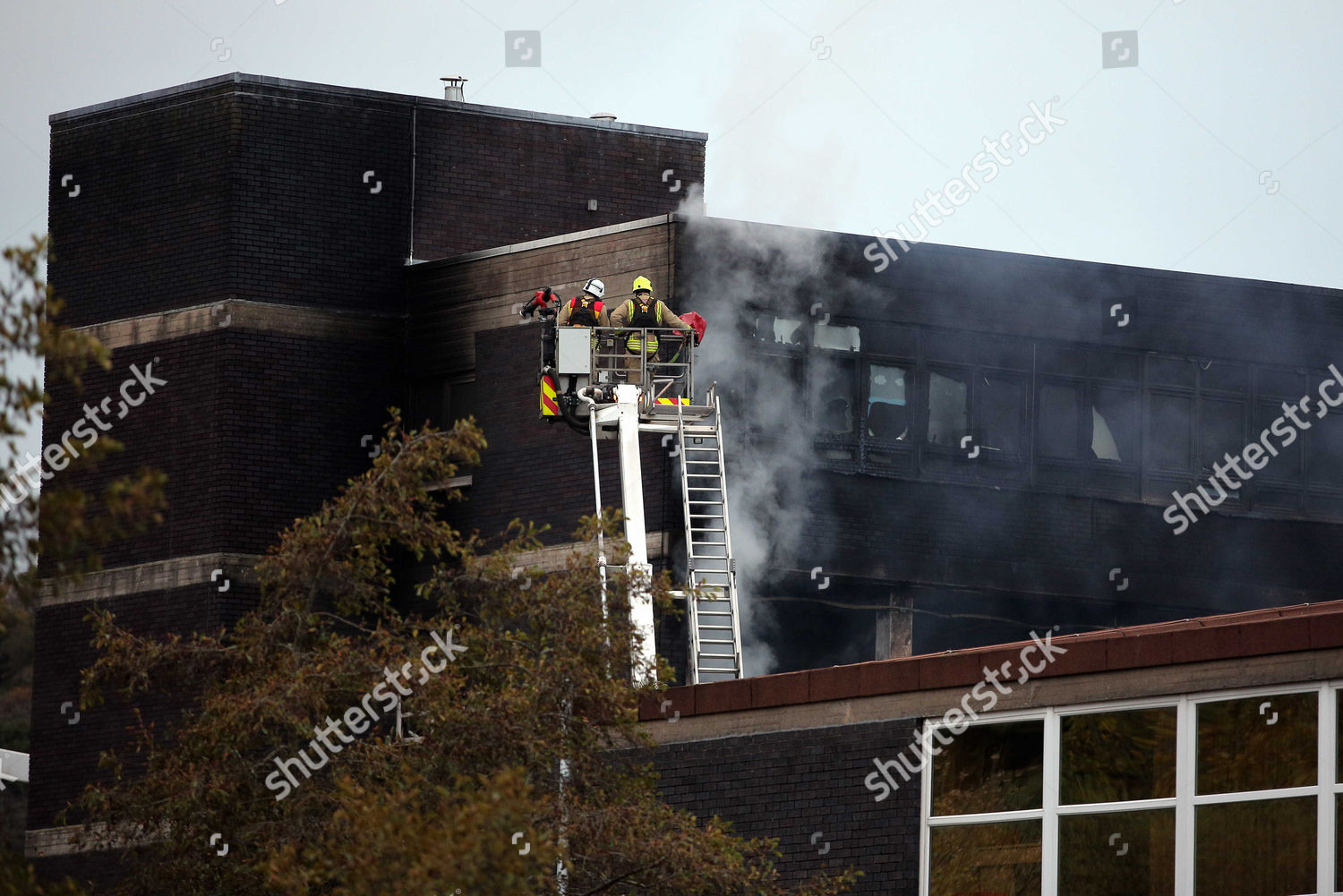 Fire fighters on aerial unit scene large Editorial Stock