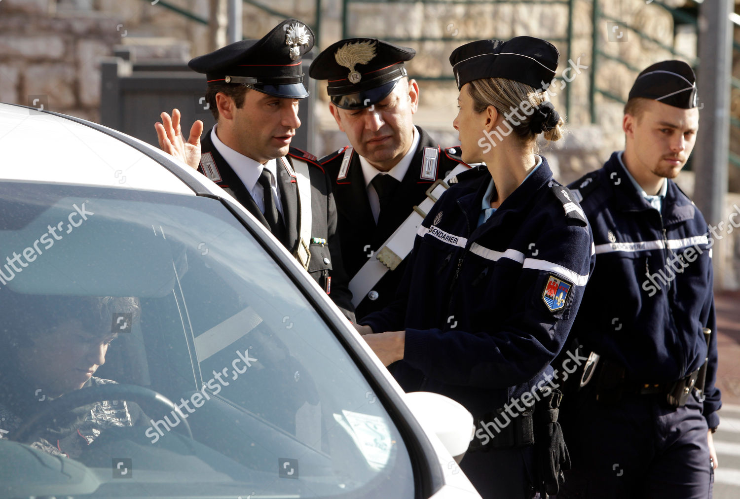 French left Italian police officers check car Editorial Stock Photo