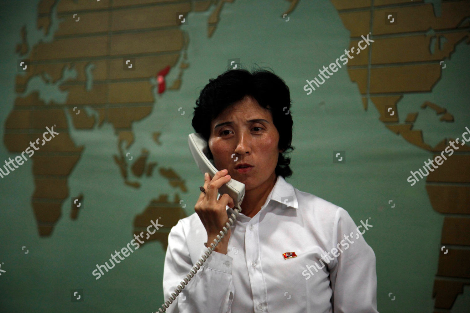 receptionist answers phone near world map marking Editorial Stock ...