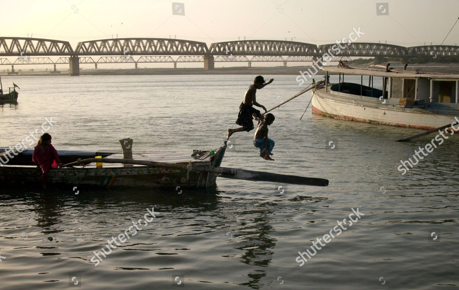 Pakistani boys jumps into Indus river cool Editorial Stock Photo