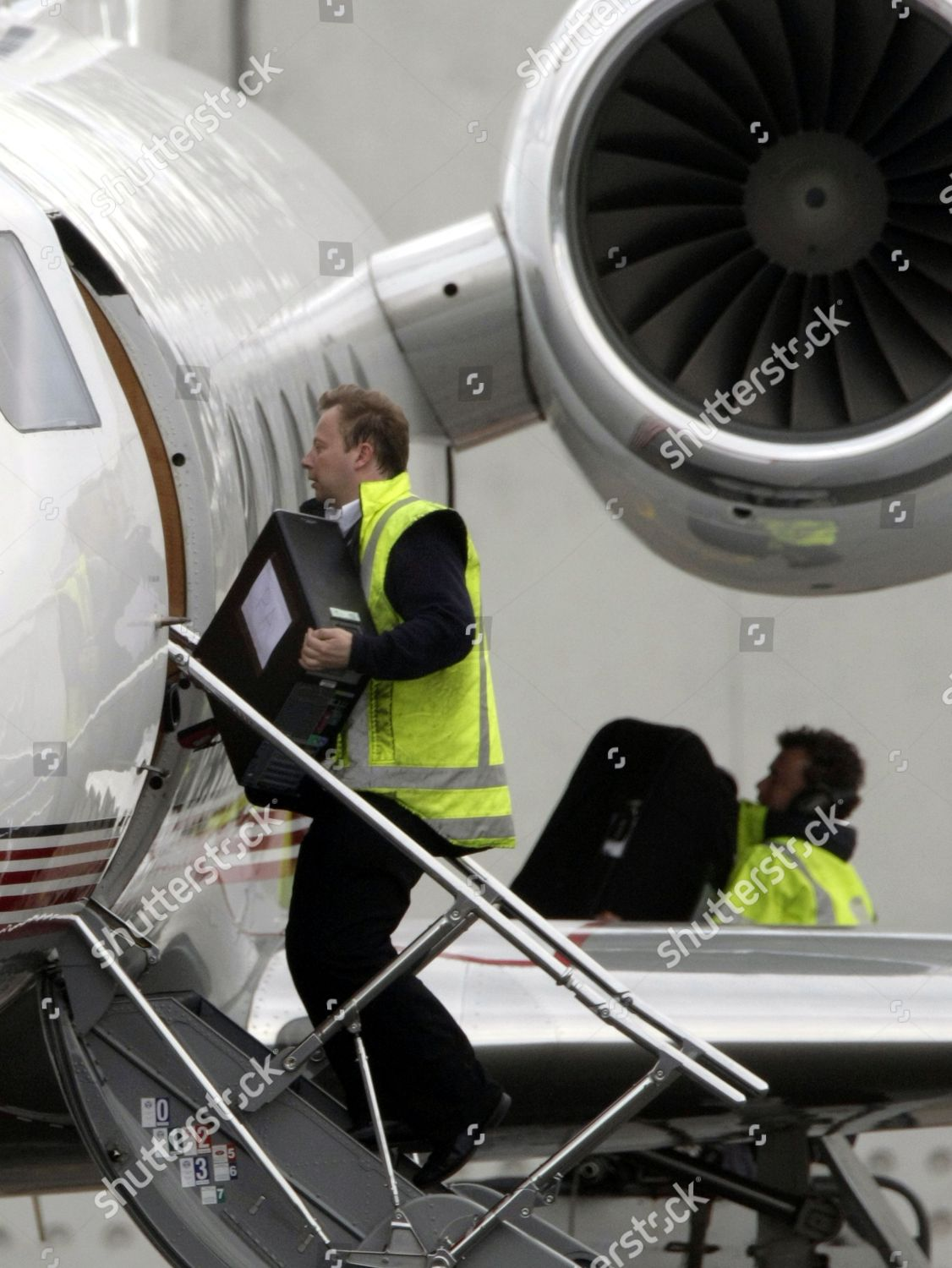 Computers bags being loaded onto aeroplane Jackson Editorial
