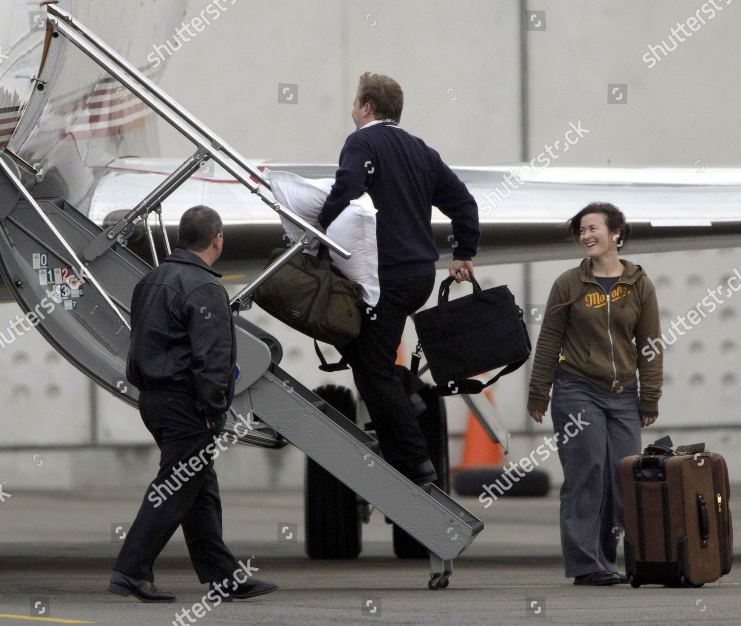 Pillows bags being loaded onto aeroplane Jackson Editorial