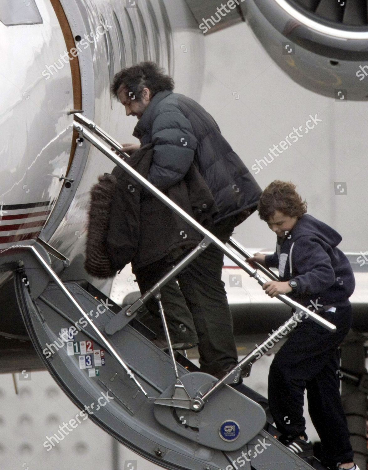 Peter Jackson boarding aeroplane his son Billy Editorial