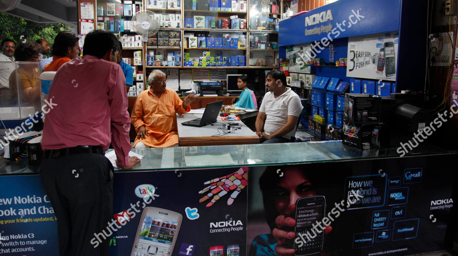 Customers stand mobile phone shop displaying Nokia Editorial