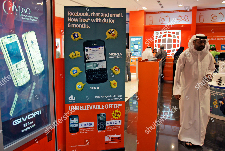Emirati man mobile phone dealer shop Dubai Editorial Stock Photo