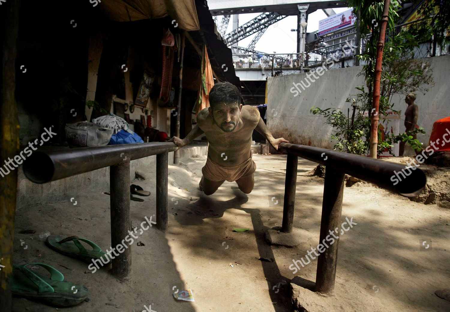 traditional Indian wrestler smeared mud exercises during