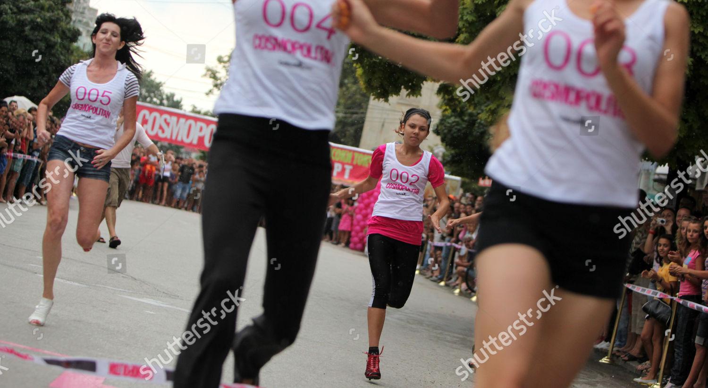 Women run on high heels during Stiletto Editorial Stock