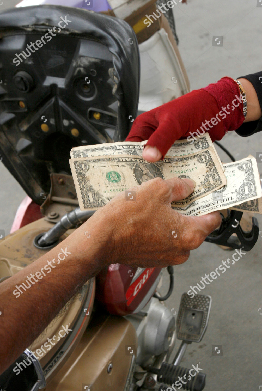 motorbike owner left pays US3 gasoline price Editorial Stock