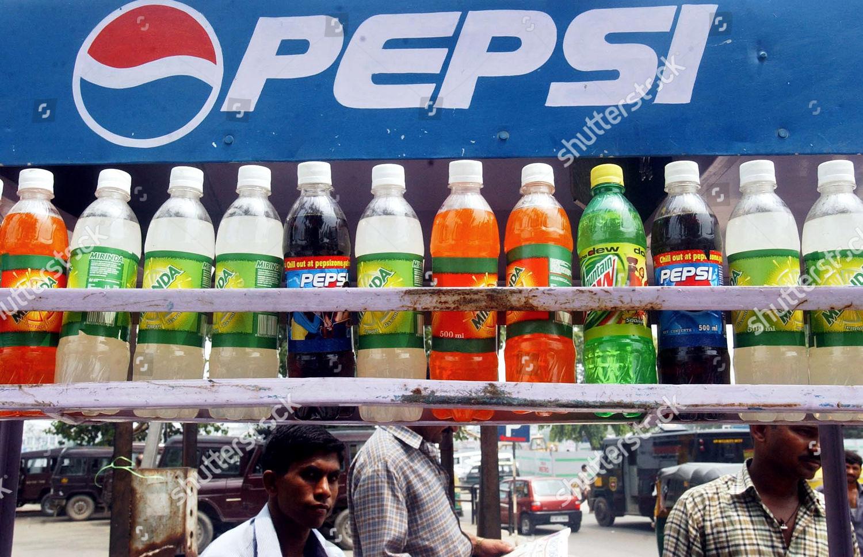 PEPSI soft drinks vendor sits behind Pepsi Editorial Stock