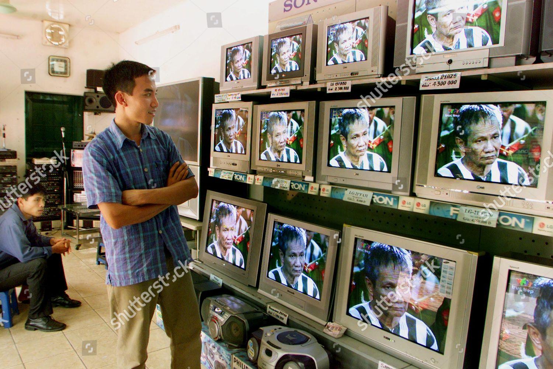 TELEVISED TRIAL Vietnamese TV store clerk watches Editorial