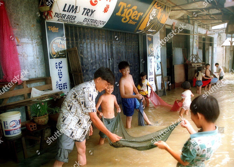 MAN HELP CHILDREN man helps children while Editorial Stock Photo