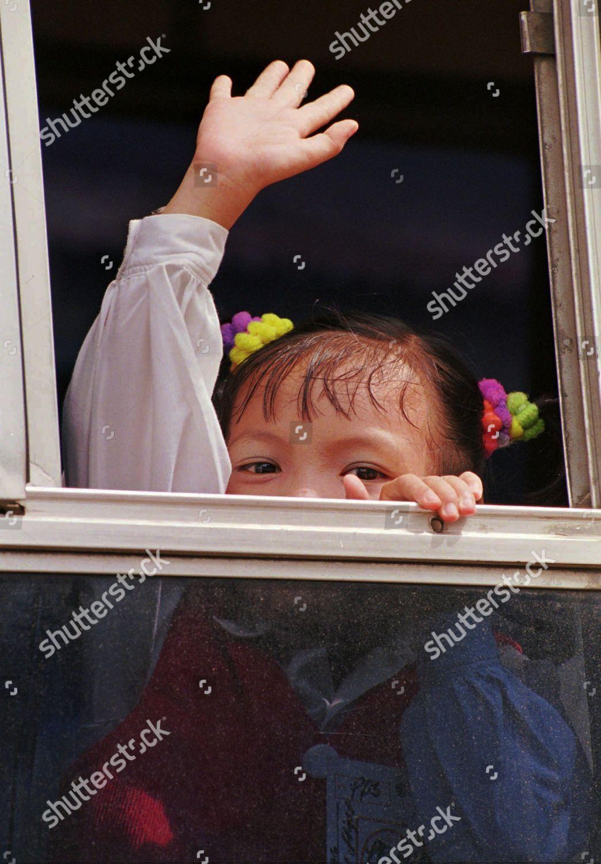 REFUGEE WAVE GOODBYE Vietnamese girl waves goodbye Editorial