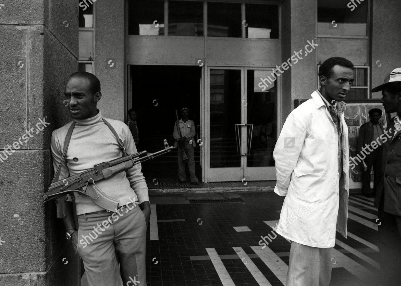 armed member Peoples Militia that patrols streets Editorial
