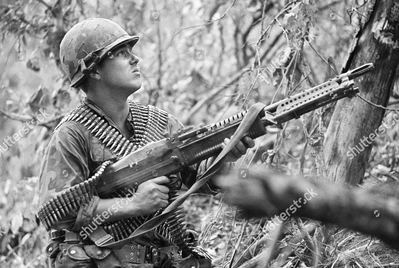 American paratrooper fires his M60 machine gun Editorial