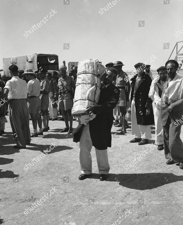 elderly Yemenite Jew carries Holy Scroll waiting Editorial