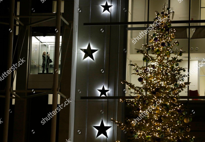 Woman Inside Elevator Takes Photograph Christmas Tree Editorial
