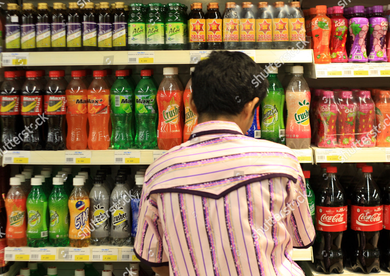 Staff Member Stacks Shelves Cocacola Products Supermarket