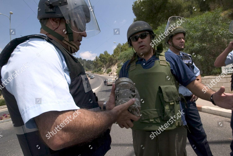 Israeli Security Personnel Holds Part Katyusha Rocket