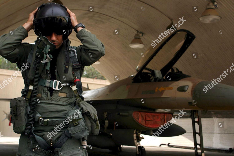 Israeli Jet Fighter Pilot Readies His Helmet Editorial Stock