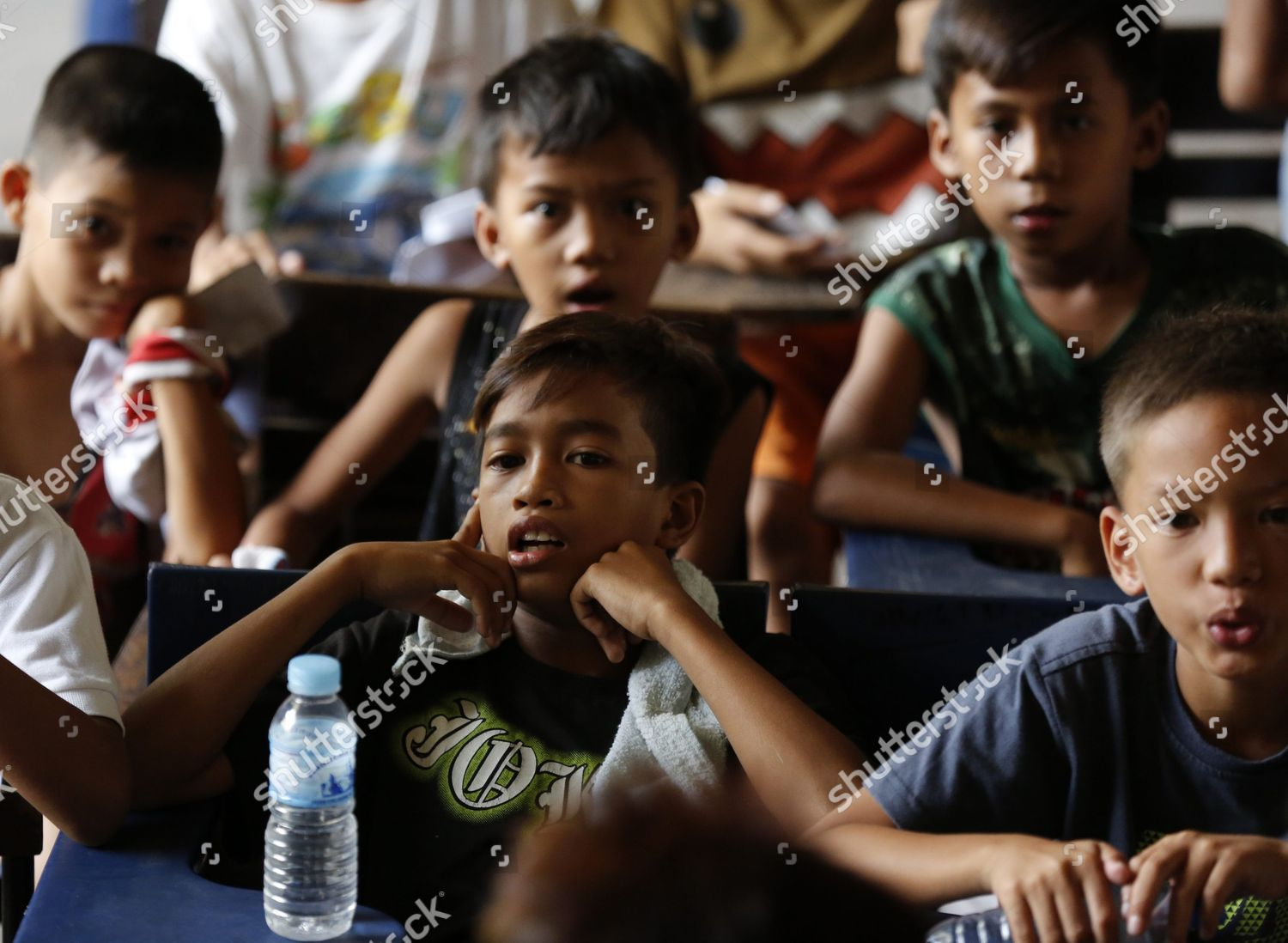 young filipino boys wait their turn get editorial stock
