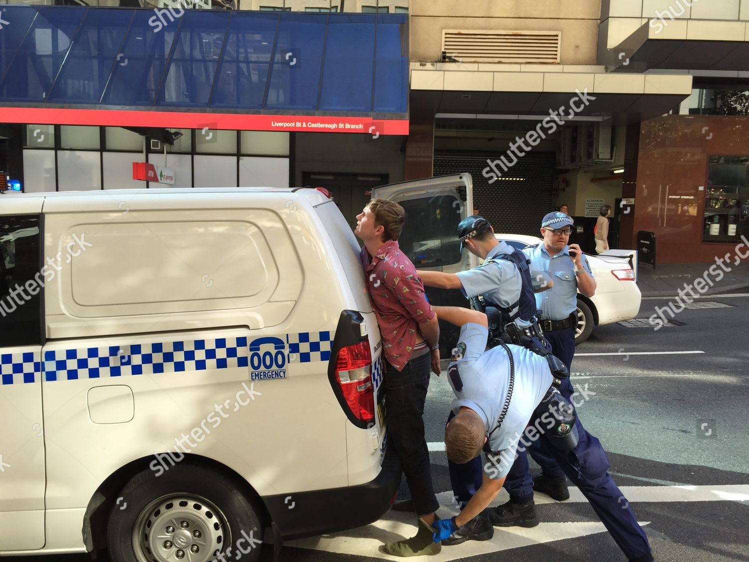 Man Taken Away by Police After Incident ...
