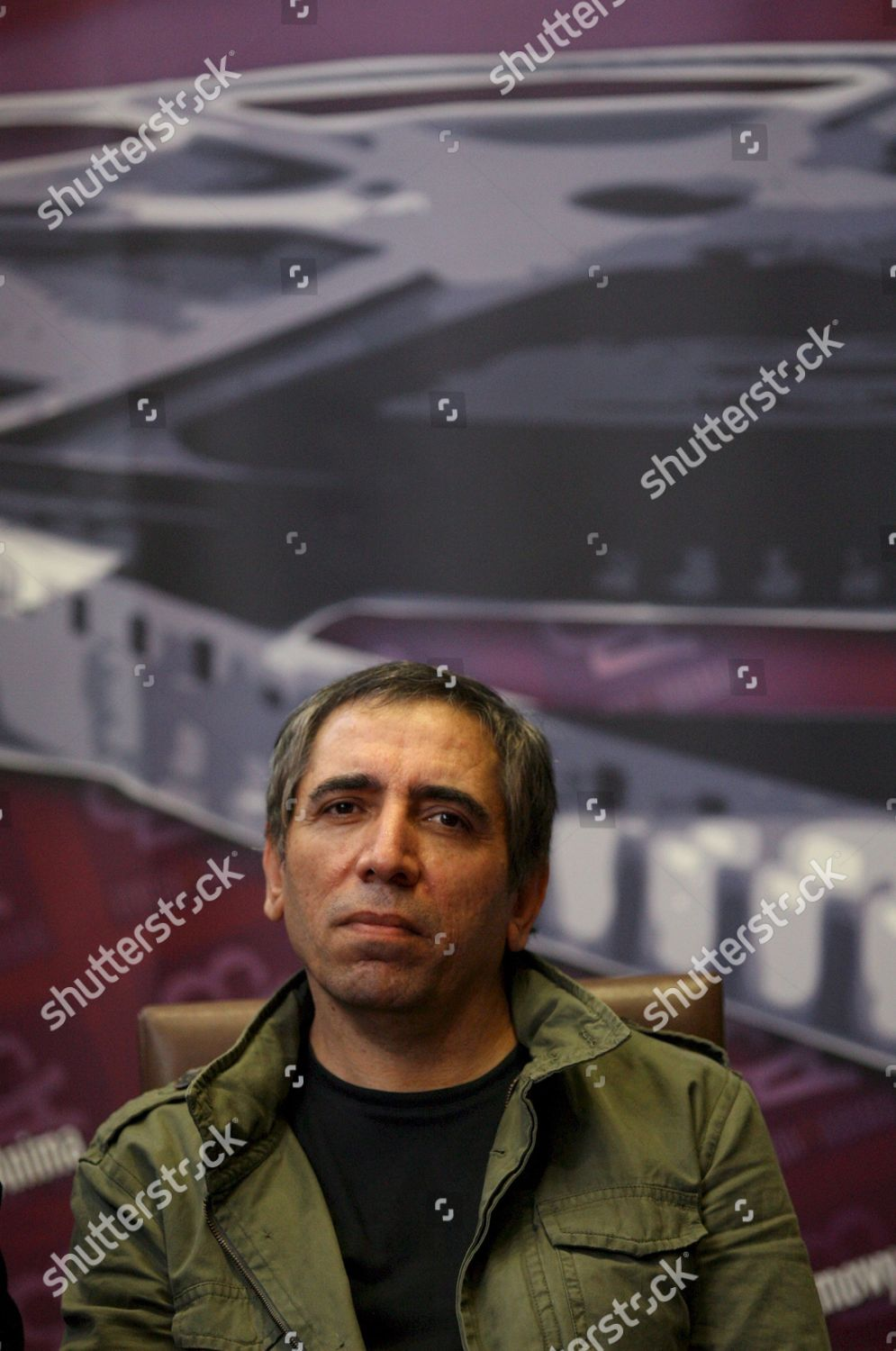Iranian Director Mohsen Makhmalbaf Looks on During Editorial Stock