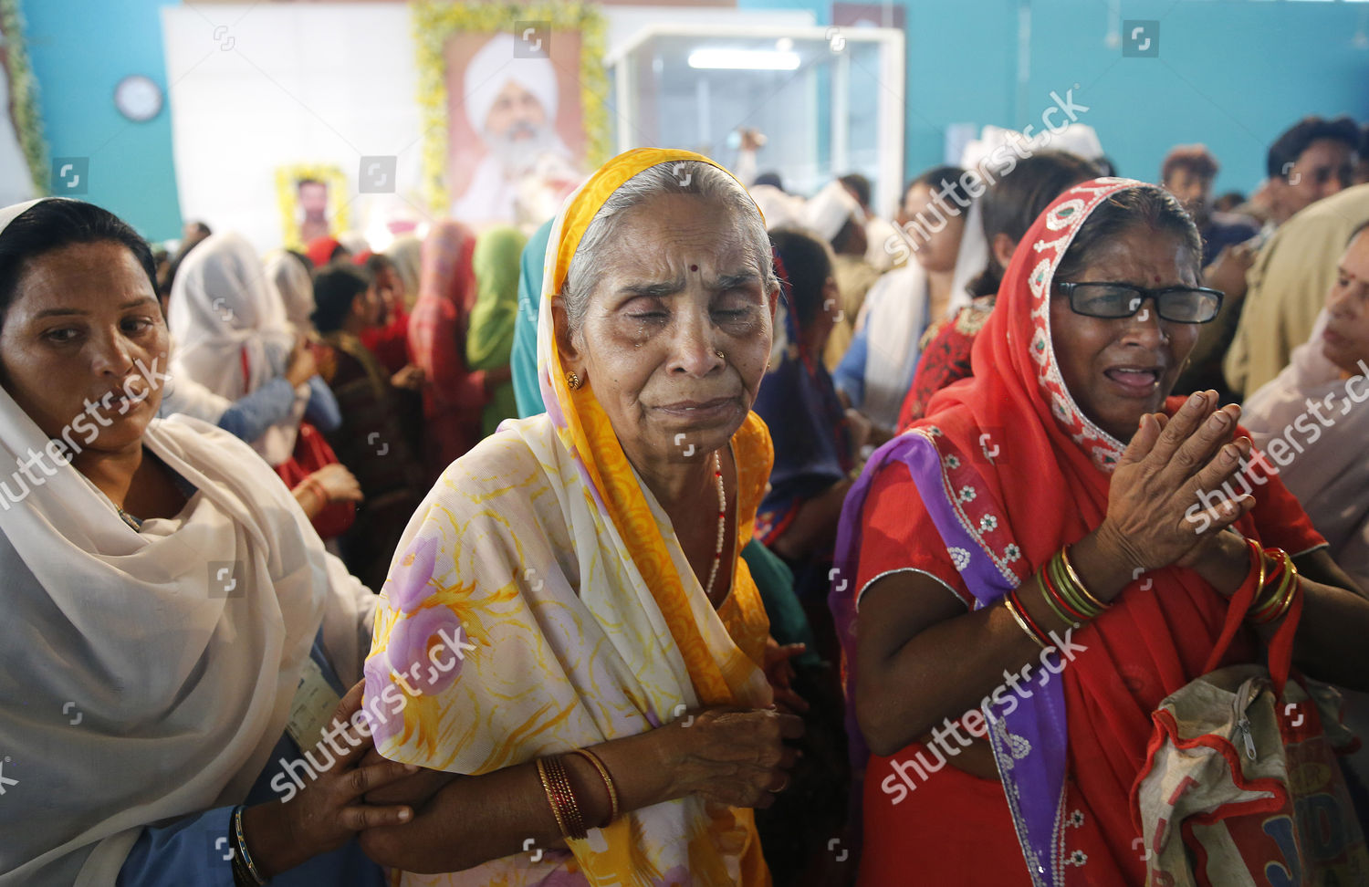 Indian Devotees Breaks out After Paying Tribute Editorial
