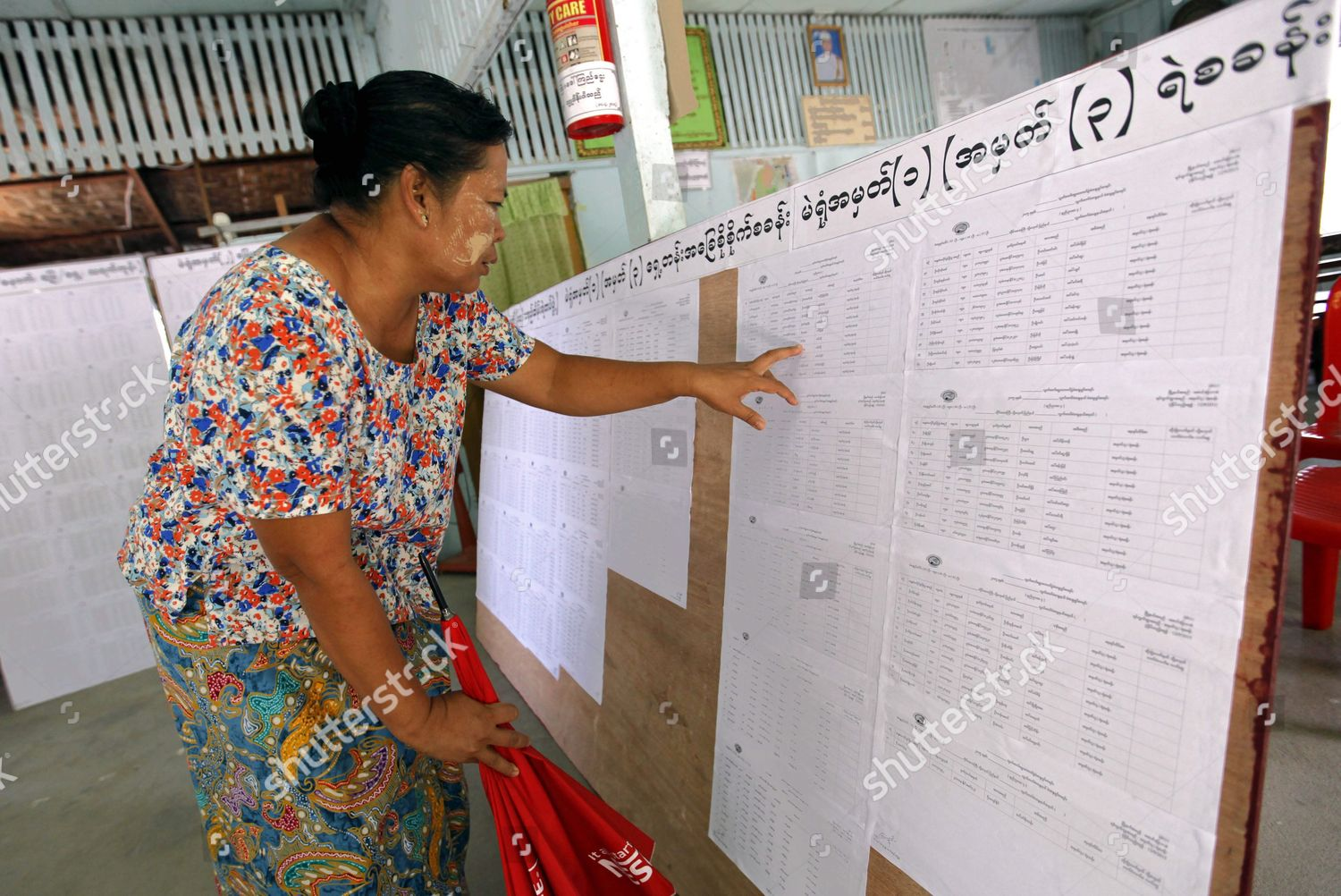 Woman Checks Her Name on Voters List Editorial Stock Photo