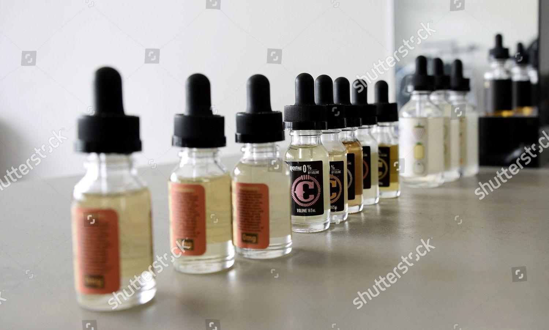 Vaporizer Juice Samples Lined on Counter Vapor Editorial