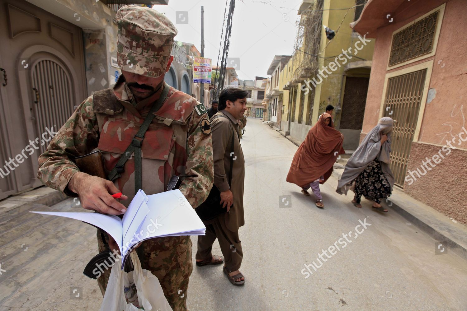Pakistani army soldiers escort census officials country Editorial