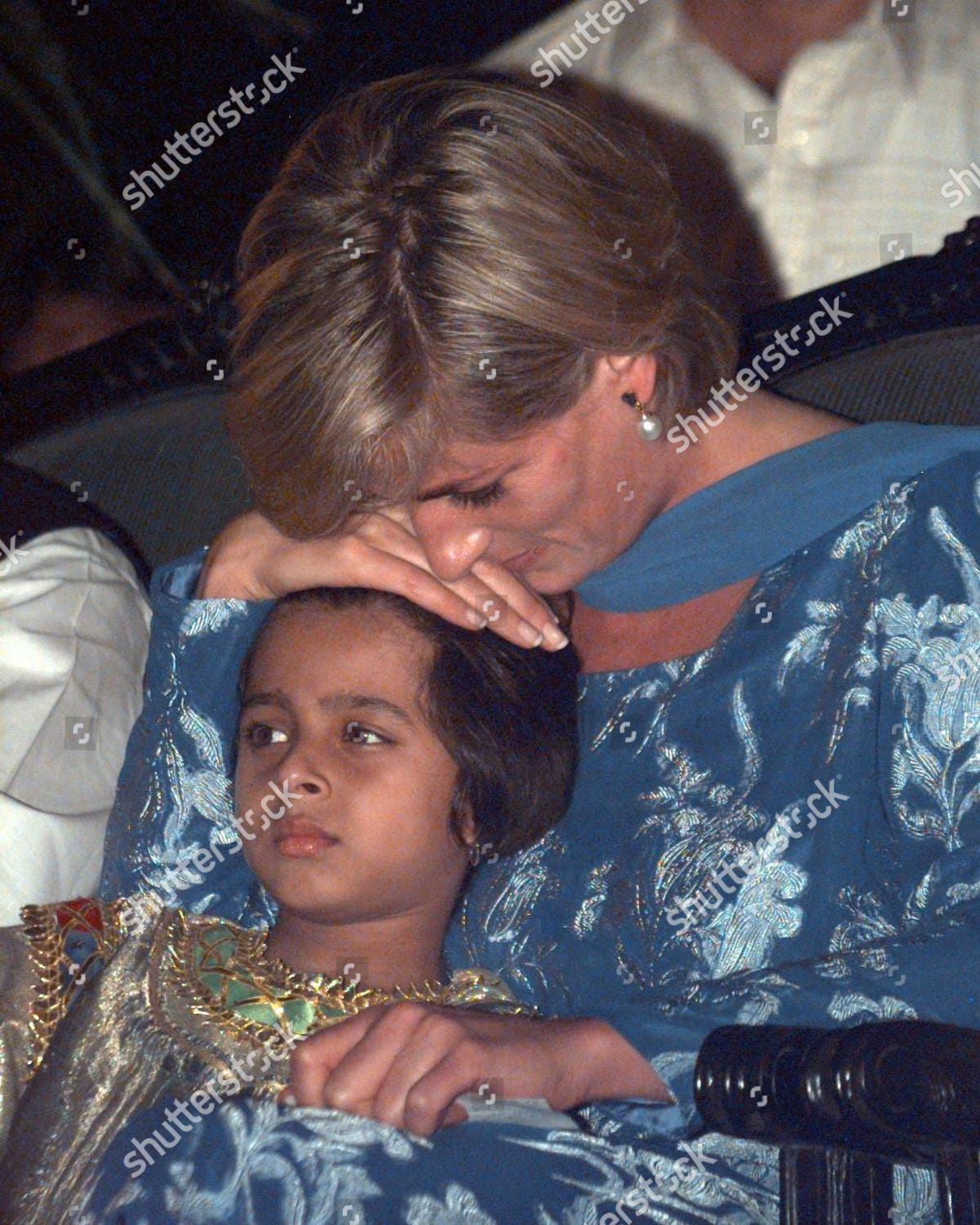 princess diana cuddles young girl imran khans editorial stock photo stock image shutterstock https www shutterstock com editorial image editorial princess diana cuddles a young girl at girl at imran khans cancer hospitalpic mike forster 867304a