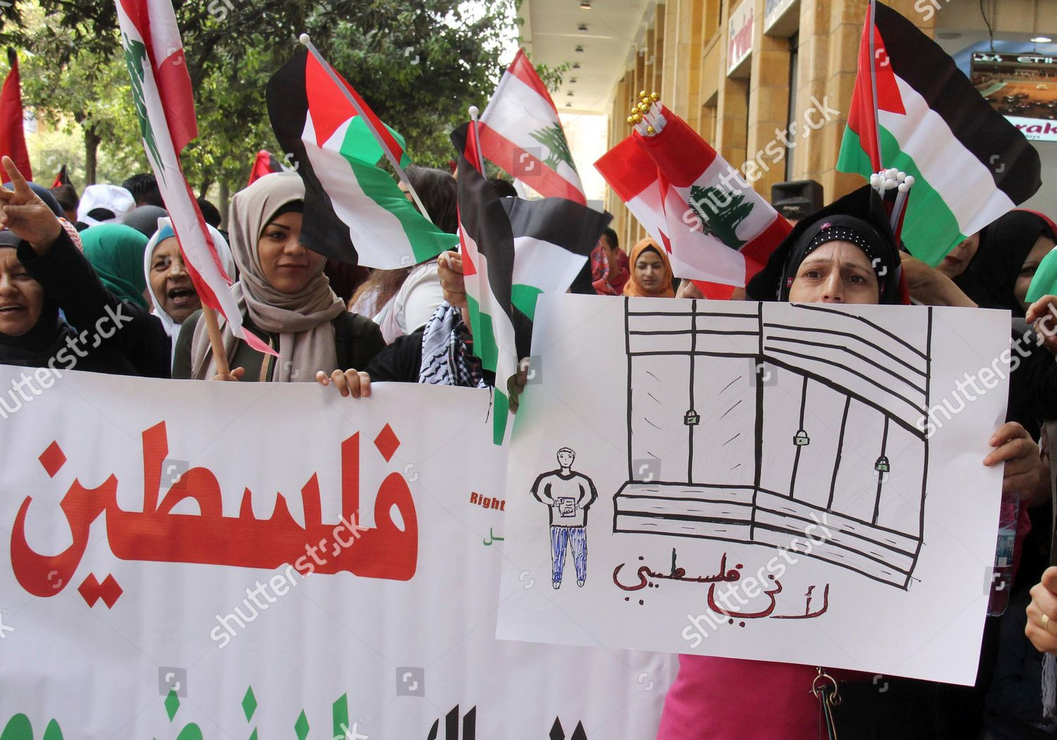 Palestinian women who live Lebanon carry placard Editorial