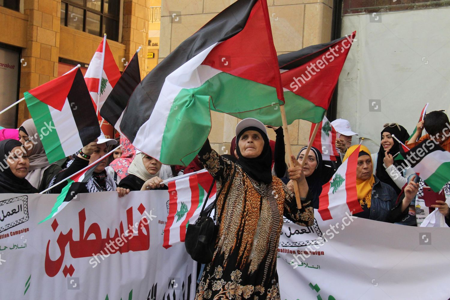 Palestinian women refugees who live Lebanon wave Editorial