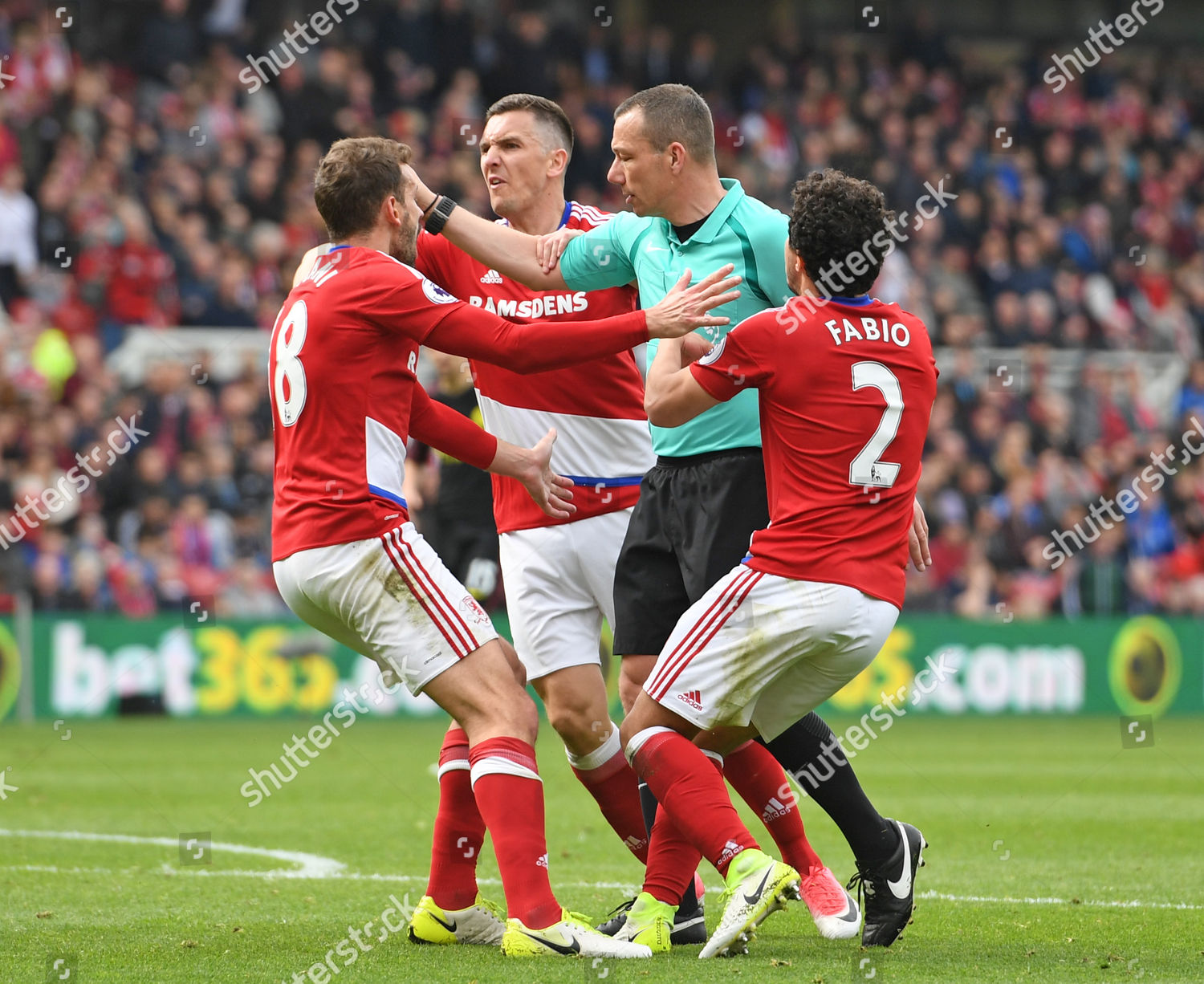 Middlesbrough players surround referee Kevin Friend after