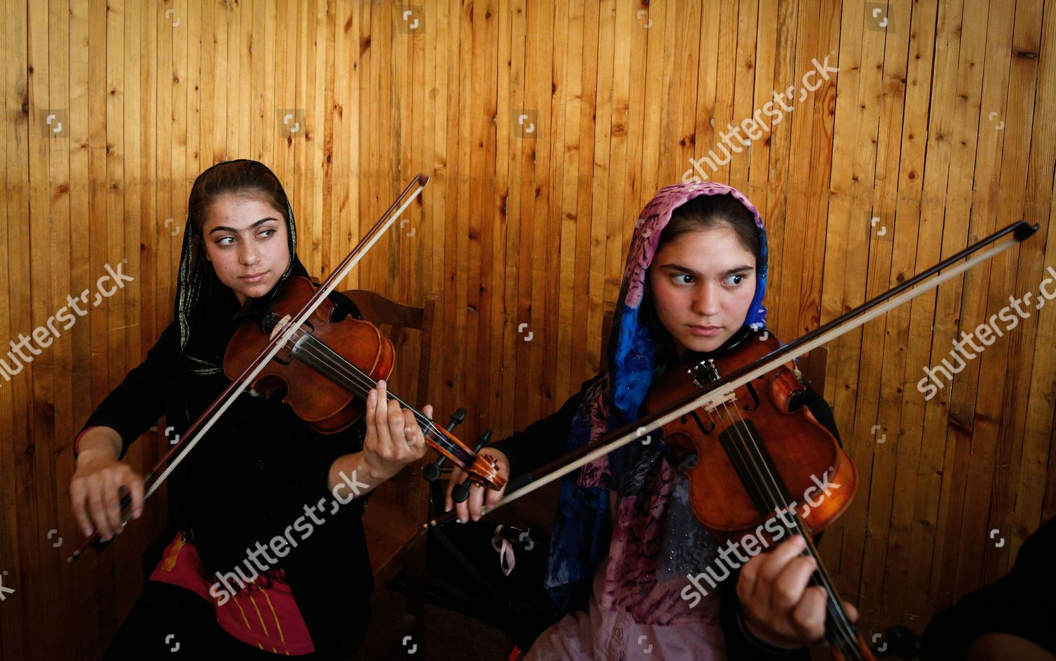 Afghan music students plays their violins during Editorial Stock