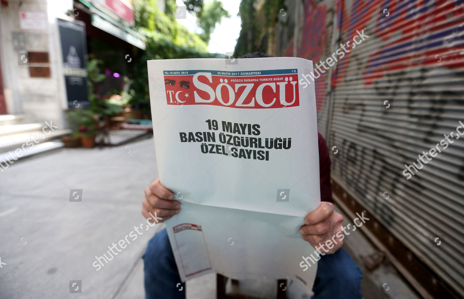 man reads Sozcu newspaper published blank pages Editorial