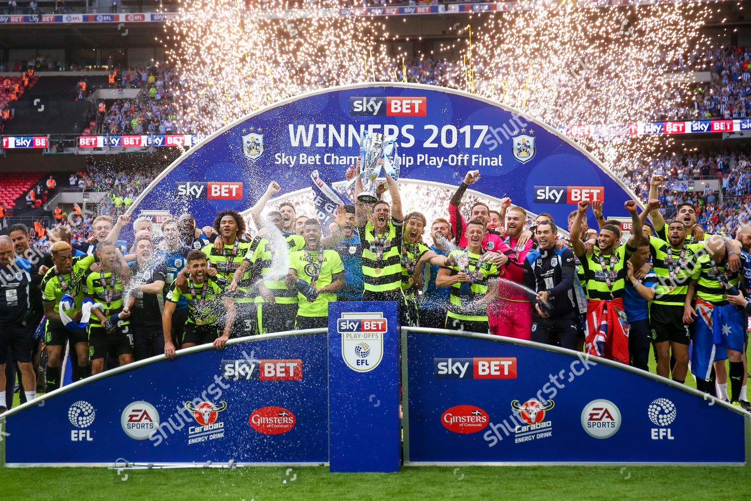 Huddersfield Town players lift trophy after winning