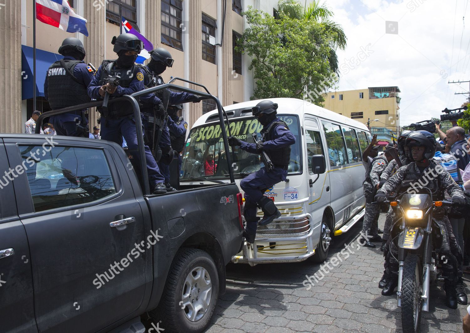 Security agents guard bus where seven detaineed Editorial Stock