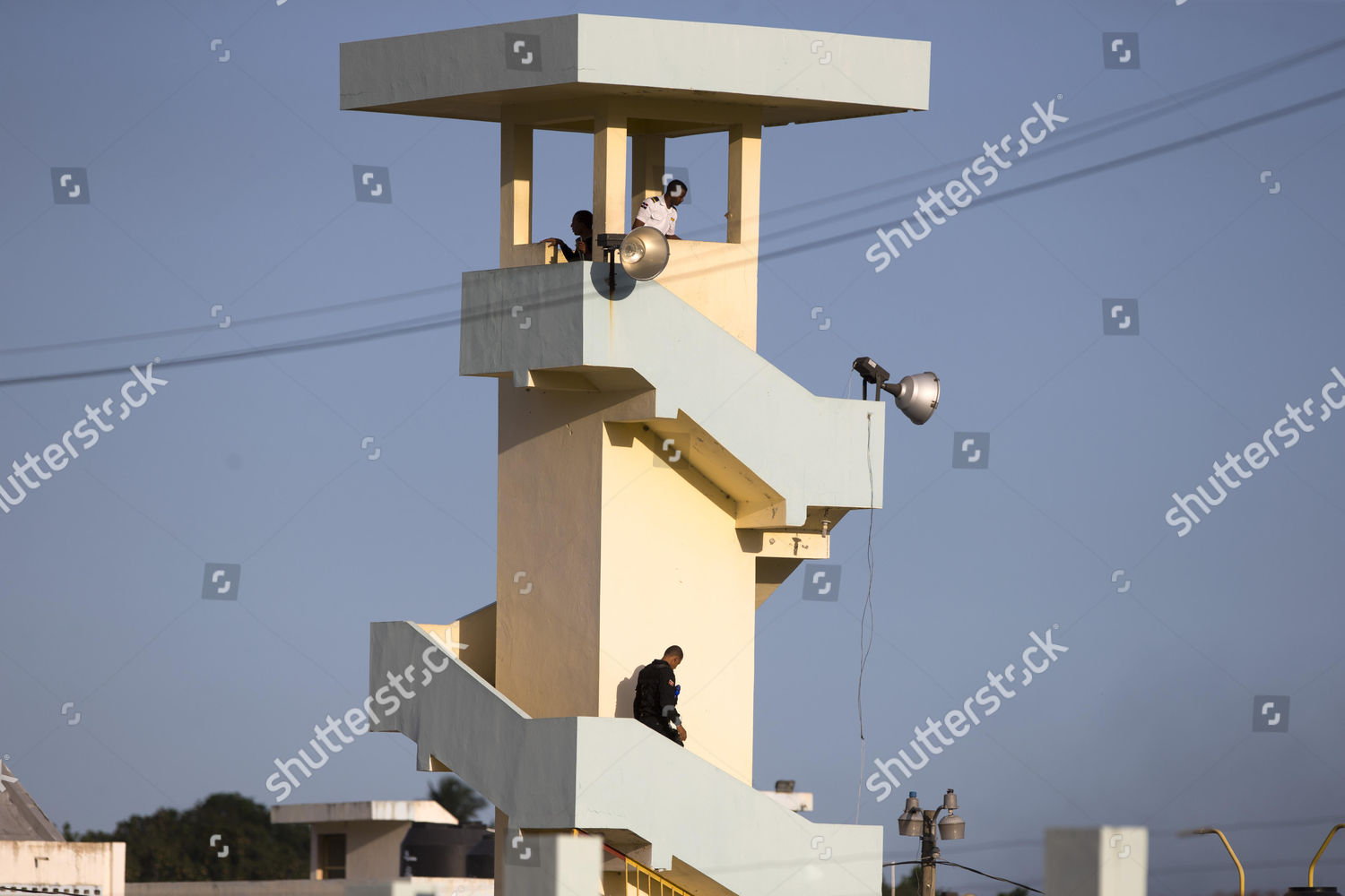 Surveillance Penitentiary Treatment members stand guard tower